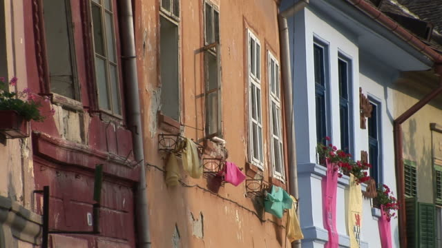 sighisoaraflags hanging on the wall sighisoara transylvania romania - sighisoara stock videos & royalty-free footage