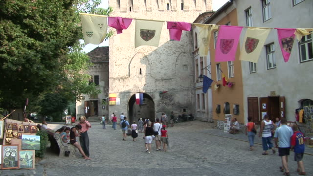 sighisoarapeople walking in a walkway sighisoara transylvania romania - transylvania stock videos & royalty-free footage