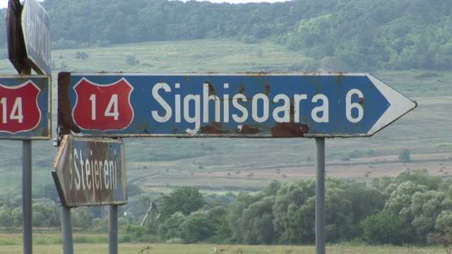 sighisoarasign boards in sighisoara romania - sighişoara video stock e b–roll