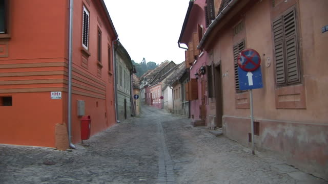 SighisoaraView of a narrow road in Sighisoara Transylvania Romania