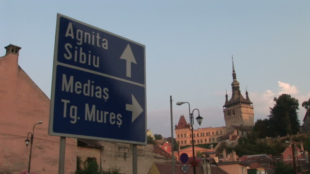 sighisoaraview of a signboard and citadel clock tower in sighisoara transylvania romania - mures stock videos & royalty-free footage