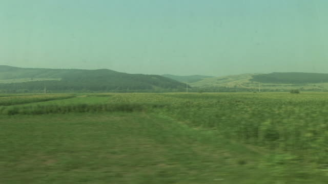 sighisoaraview of agriculture landscape from a moving train in sighisoara transylvania romania - mures stock videos & royalty-free footage