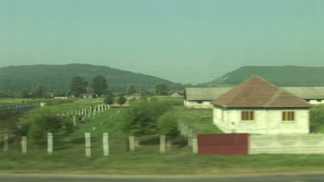 vídeos y material grabado en eventos de stock de sighisoaraview of agriculture landscape from a moving train in sighisoara transylvania romania - sighisoara