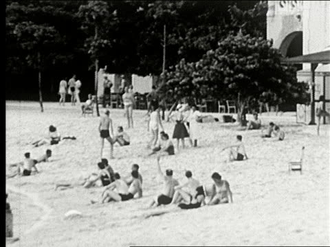 sights of havana sailboats in harbor and beach with beach club house sunbathers boulevard with cars along seawall waves crashing seaside road museum... - hotel nacional stock videos and b-roll footage