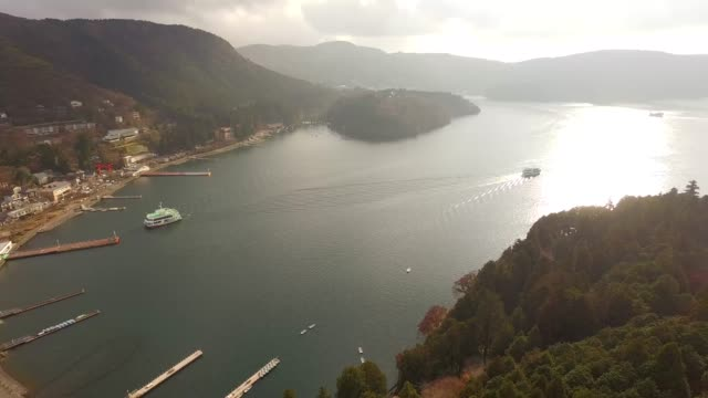sight-seeing boat cruising on lake ashi, overlooking mount fuji and owakudani valley in hakone, japan - shrine stock videos & royalty-free footage