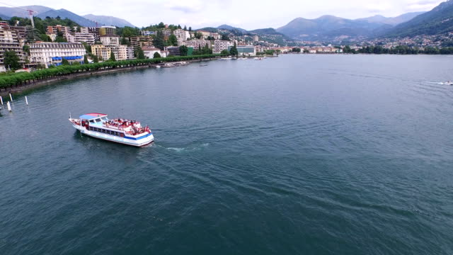 a sightseeing boat cruising on lake lugano, switzerland - ticino canton stock videos and b-roll footage