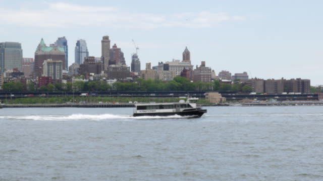Sightseeing boat in east river, New York City