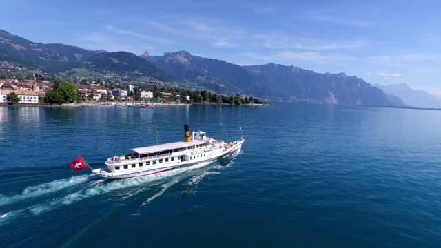 a sightseeing boat passes by montreux, switzerland on its day trip on lake geneva - montreux stock videos & royalty-free footage