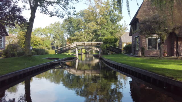 sightseeing boat sailing in giethoorn canals in netherlands - cottage stock videos & royalty-free footage