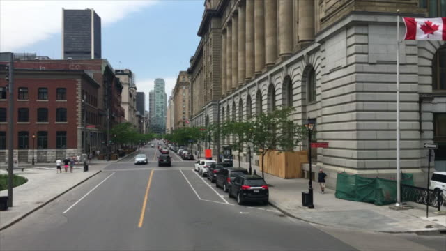 sightseeing montreal city downtown district in tourist bus. the old architecture and other attractions make the city a tourist attraction in canada - street name sign stock-videos und b-roll-filmmaterial