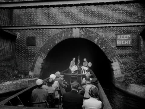 a sightseeing narrow boat travels through a tunnel during its tour along london's grand union canal 1951 - narrow stock videos & royalty-free footage