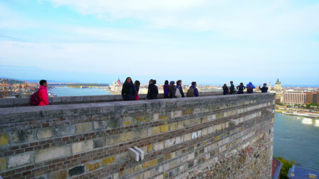 sightseers viewing budapest from the castle hill - castle hill budapest stock videos and b-roll footage