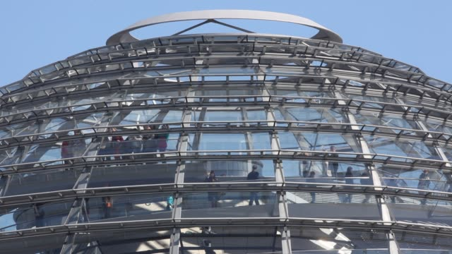 Sightseers visit the Glas dome at the Reichstag building on May 3 2014 in BerlinGermany