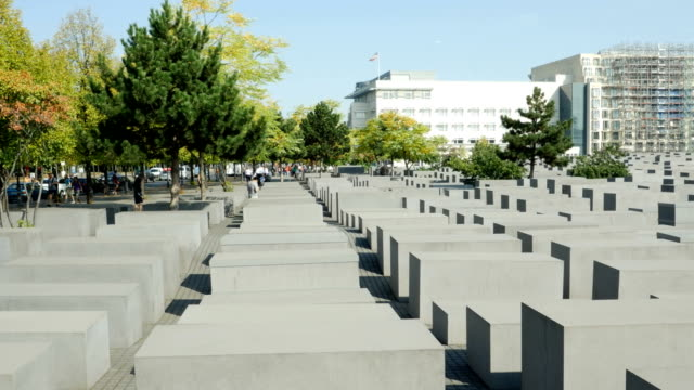 Sightseers visiting the Memorial to the Murdered Jews of Europe in Berlin on sunny september day In the background the Embassy of the United States...