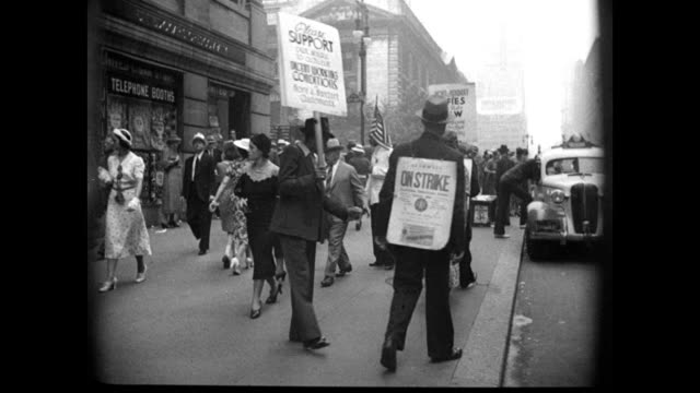 Sign '6 Hour Day for All Workers' VS New Yorkers on strike picket lines signs WS Mayor Fiorello LaGuardia addressing crowd microphone WS Crowd of...