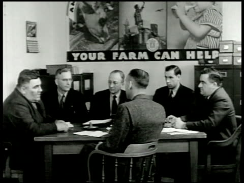 vídeos de stock, filmes e b-roll de sign aaa farm program county war board meeting sot farmer asking if approved power line extension board member saying yes for milking machines... - 1943