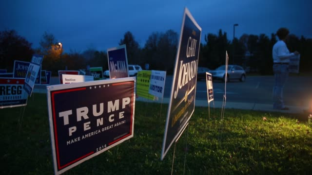 a sign advertises donald trump's presidential campaign outside the sherwood oaks christian church in bloomington indiana on election day 2016 the... - 2016年点の映像素材/bロール