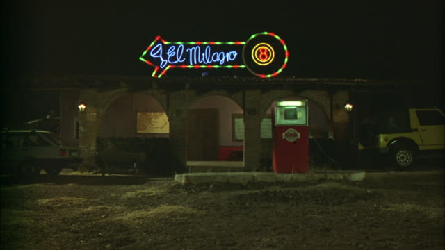 stockvideo's en b-roll-footage met a sign advertises for the el milagro bar in mexico. - bar gebouw