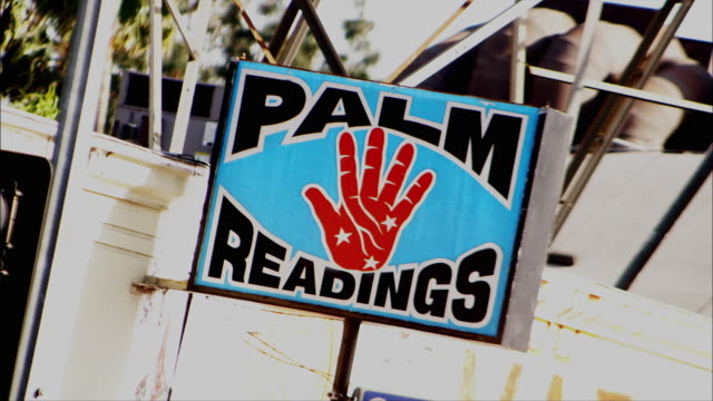 a sign advertises palm readings. - fortune telling stock videos and b-roll footage