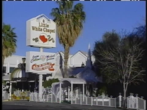 sign advertises the little white wedding chapel where britney spears got married to jason allen alexander. - 2004 stock videos & royalty-free footage