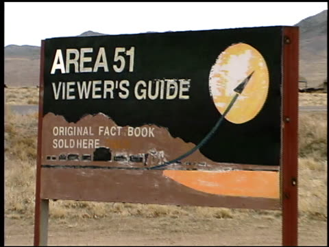 a sign advertises viewer's guides for area 51. - ufo stock videos & royalty-free footage