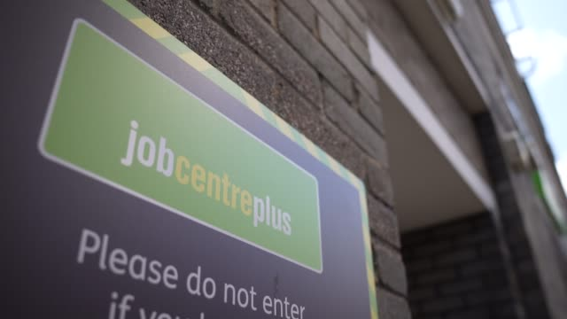 sign advises vistors not to enter if they have any covid-19 symptoms at the entrance of a job centre plus employment office on august, 2020 london... - unemployment stock videos & royalty-free footage