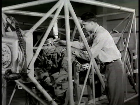 stockvideo's en b-roll-footage met sign aero medical laboratory centrifuge in room pilot hooked in centrifuge prone position centrifuge operator sitting putting on mouthpiece working... - 1948