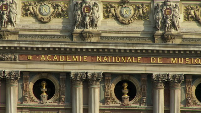 cu pan sign and ornaments on national music academy, paris, france - place de l'opera stock videos and b-roll footage