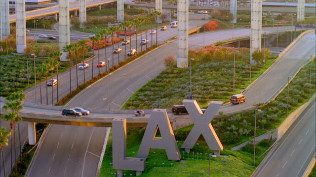 WS LAX sign and traffic on elevated road / Los Angeles, California, USA