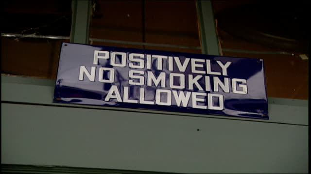 sign asking people under 18 be accompanied by an adult and no smoking sign in snohomish, washington - no smoking sign stock videos & royalty-free footage