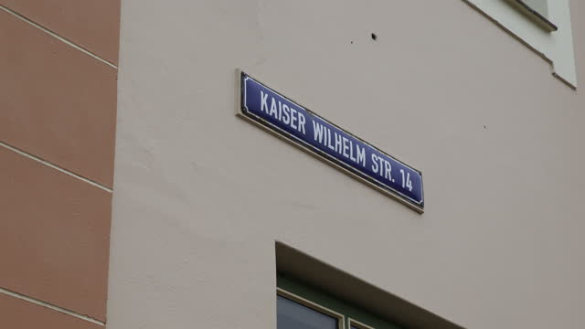 sign at a building indicates a street named after kaiser wilhelm in swakopmund, namibia, on april 4, 2019. kaiser wilhelm is a common reference to... - カイザー・ヴィルヘルム記念教会点の映像素材/bロール