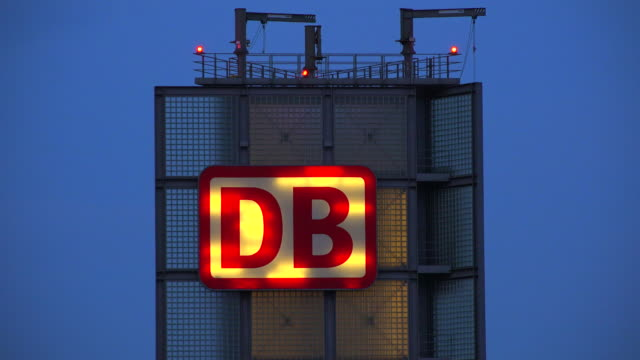 db sign (deutsche bahn) at central station, berlin, germany - schild stock-videos und b-roll-filmmaterial