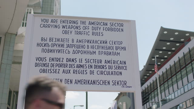 sign at checkpoint charlie (berlin wall crossing point) / berlin, germany - symbols of peace stock videos & royalty-free footage