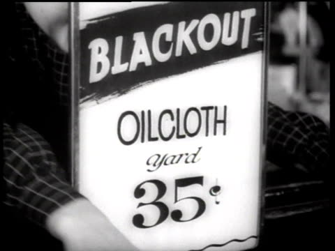 cu sign at woolworth's department store advertising blackout oilcloth by the yard / new york city new york united states - 1942年点の映像素材/bロール