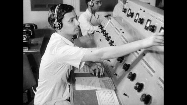 sign; 'broadcasting house' technician adjusting levels. male radio announcer sot speaking subtitled: 'the role asia has been playing has not been... - radio studio stock videos & royalty-free footage