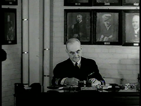 stockvideo's en b-roll-footage met sign 'bureau of naval personnel' int vs vice admiral randall jacobs at desk w/ male assistant int ms officer workers in personnel department ms man... - 1942