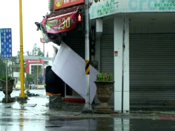 sign comes loose and flies towards camera, almost hitting cameraman; typhoon morakot, taiwan 7th august 2009 (with audio) - power in nature stock videos & royalty-free footage