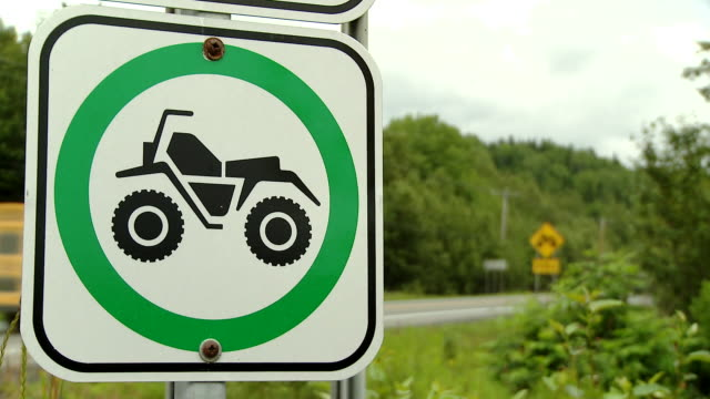 A sign crossing clearance ATV