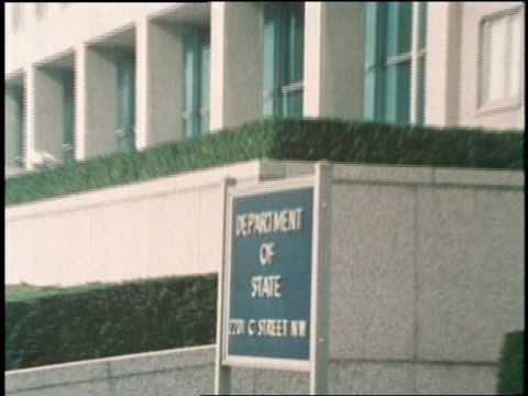 a sign designates a building at the state department building in washington dc - washington state stock videos and b-roll footage