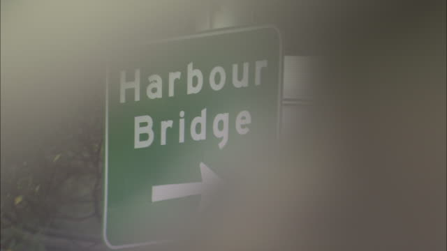 a sign directs traffic to harbour bridge in sydney, australia. - road sign stock videos & royalty-free footage