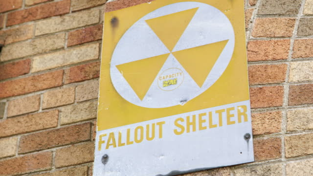 cu r/f sign 'fallout shelter' with radioactive symbol - radiation stock videos & royalty-free footage