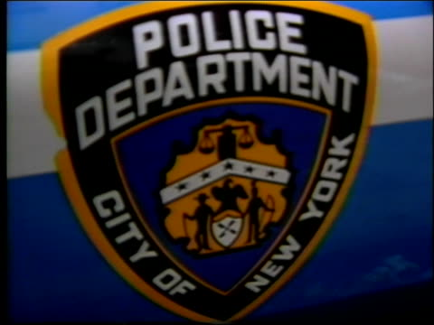 "sign for 10th precinct police department in chelsea neighborhood / shield on side of police car that reads, ""police department city of new york"" /... - chelsea new york stock videos & royalty-free footage"