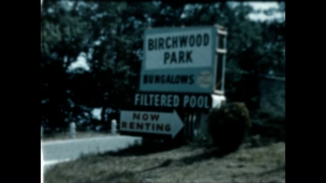 Sign for Birchwood Park Bungalows / family adults and children playing in backyard