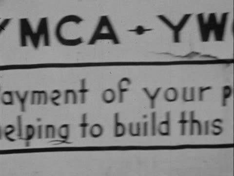 1950 MONTAGE B/W Sign for 'Carver Memorial Youth Center' requesting donations and youth center building under construction/ Greenwood, Tulsa, Oklahoma, USA