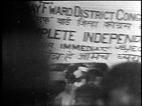 b/w 1930 sign for complete independence at antibritish demonstration / bombay india / newsreel - independence stock videos & royalty-free footage