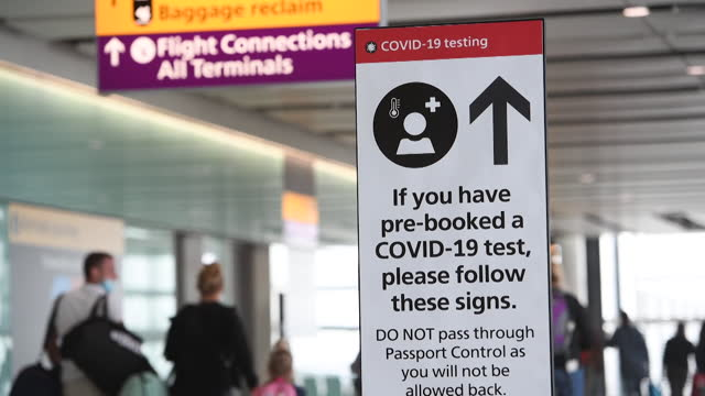 "sign for covid-19 tests in heathrow airport - ""bbc news"" stock videos & royalty-free footage"