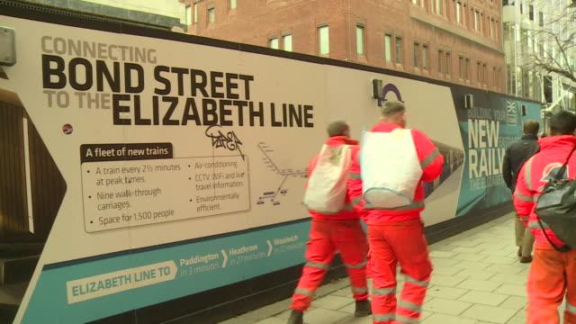 sign for crossrail elizabeth line at bond street - クロスレール路線点の映像素材/bロール