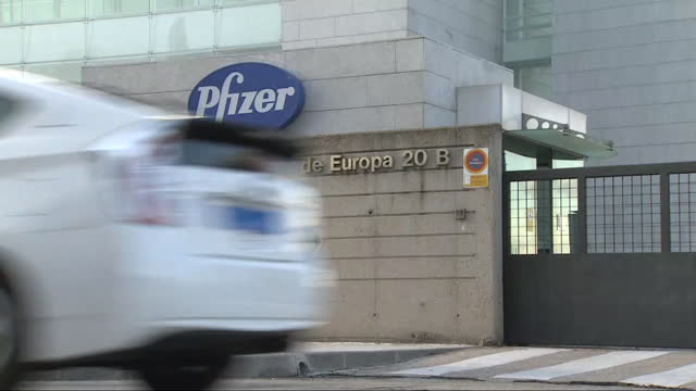 sign for pfizer is seen outside the pfizer headquarters. pharmaceutical company pfizer announced positive early results on its covid-19 vaccine trial... - headquarters stock videos & royalty-free footage