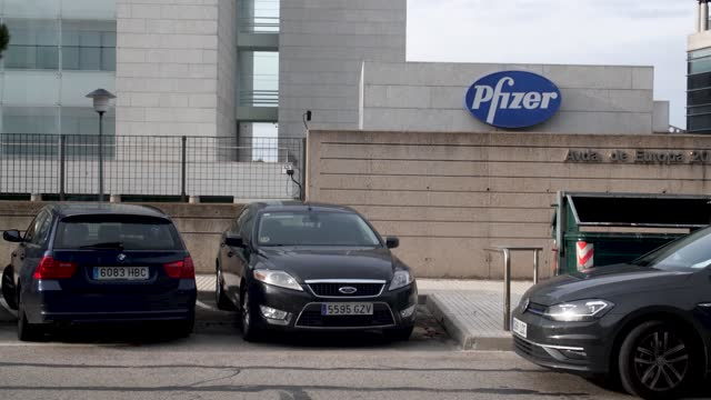 sign for pfizer is seen outside the pfizer headquarters on november 12, 2020 in alcobendas, madrid, spain. pharmaceutical company pfizer announced... - headquarters stock videos & royalty-free footage
