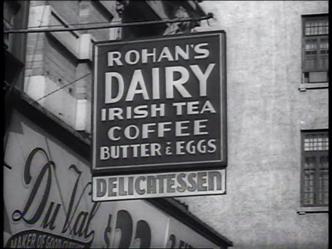 1941 CU sign for Rohan's Dairy Irish Tea Coffee Butter and Eggs Delicatessen / New York City, New York, United States
